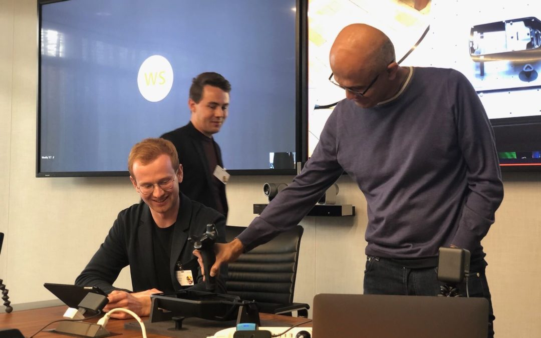 Microsoft's Satya Nadella remote teaches a robot from the USA to Germany